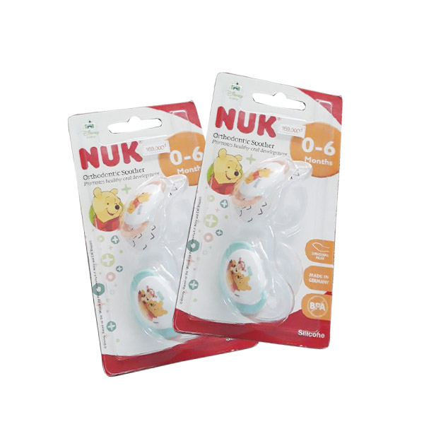Ty holds Nuk silicone double Disney sleptime 0 to 6th